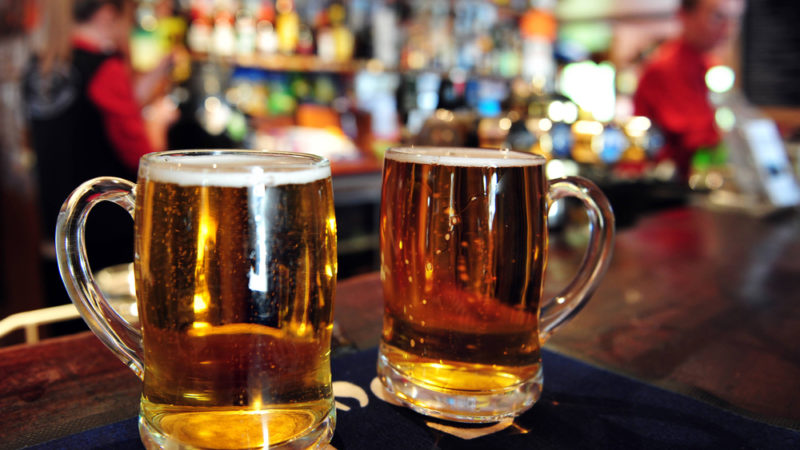 Two cups of beer in a pub in New Zealand