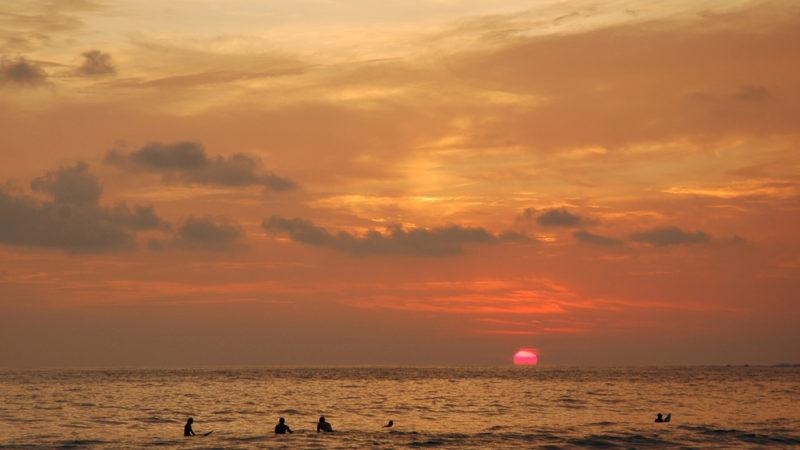sunset surfing costa rica