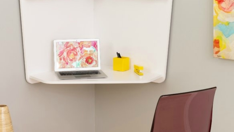 Convert any corner in your home into a mini office with this floating corner desk.