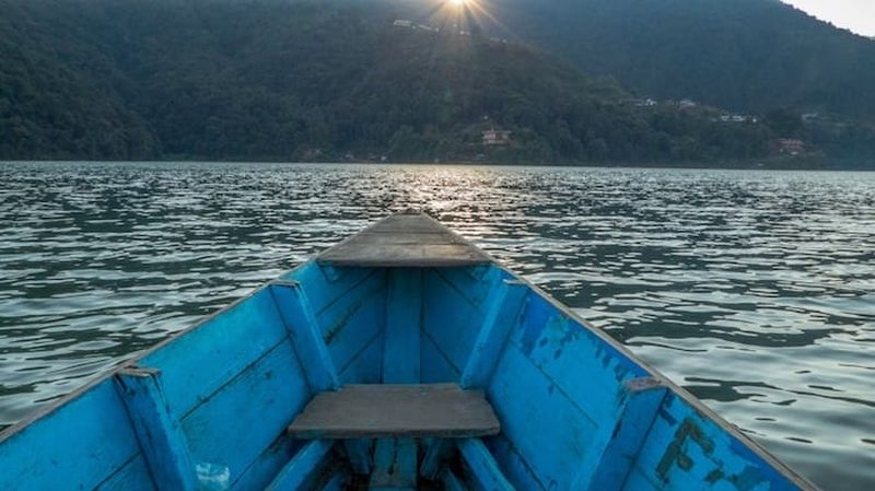 Rowing across Phewa lake to begin our hike