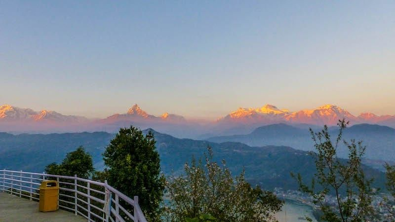 The sun setting over Pokhara and surrounding valleys
