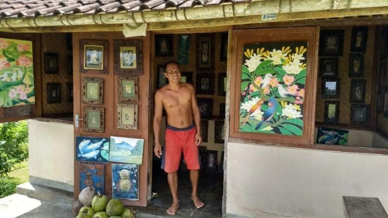 The artist, Gusti, in his roadside studio outside Ubud.