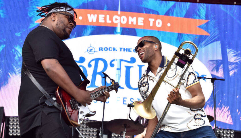 Trombone Shorty (R) of Trombone Shorty & Orleans Avenue performs during the 2019 Tortuga Music.