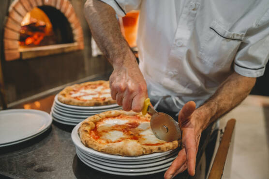 chef preparing pizza at the restaurant