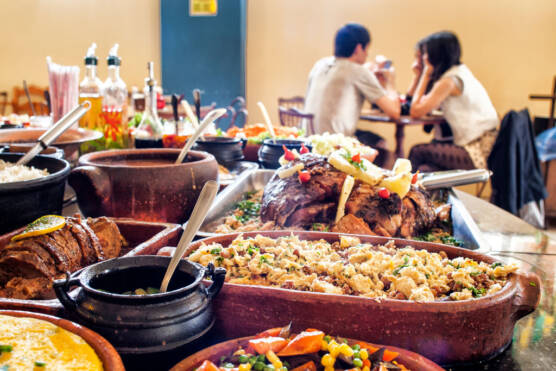 Typical Brazilian food buffet displayed at Uai di Minas