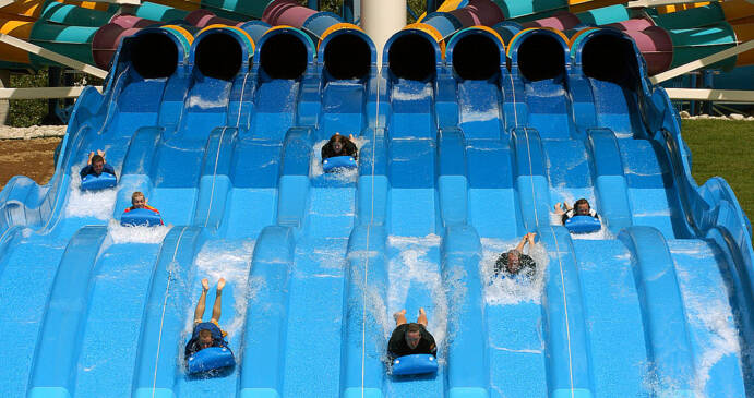 Riders slide down an enclosed tube.