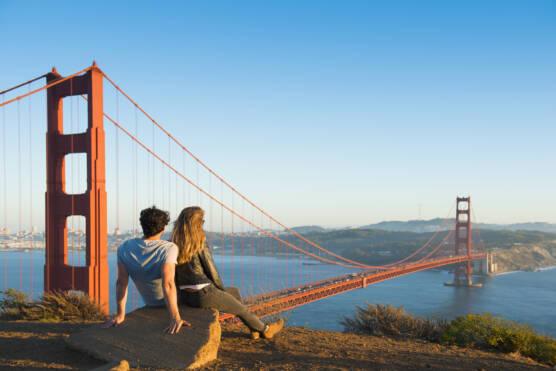 Couple admiring Golden Gate Bridge, San Francisco, California, United States