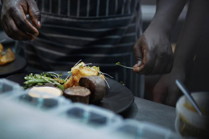 chef finishing dish