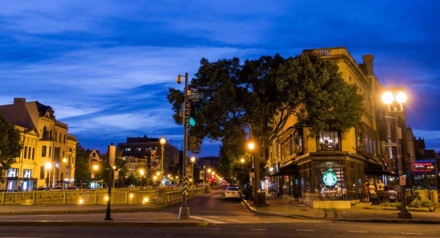 Washington DC, DuPont Circle, Street corner with Starbucks Coffee at dusk.
