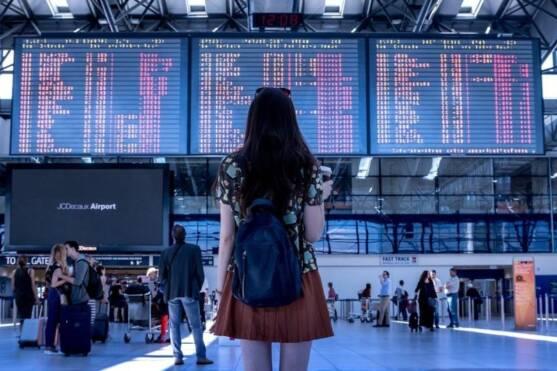 Girl at airport monitors