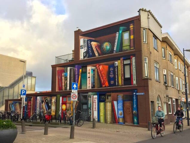 Dutch Street Artists Paint Literary Mural On Apartment Building of Residents' Favorite Books