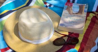 Beach Hat, Sunglasses, & Book on Towel