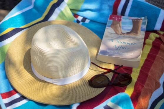 Beach Hat, Sunglasses, & Book on Towel