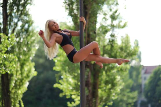 Blonde Woman Dancing on Pole