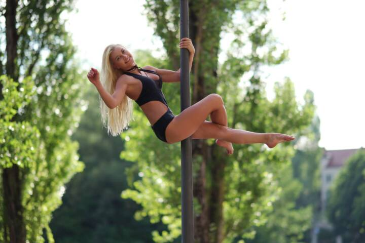 Blonde Woman Dancing on Pole