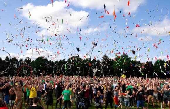 Renaissance Festival Crowd Throwing Pins