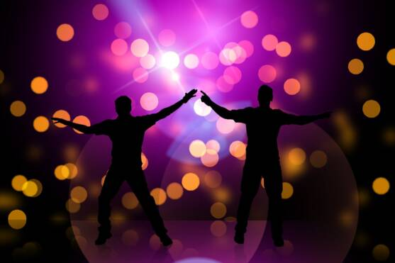 Silhouettes of two dancing men