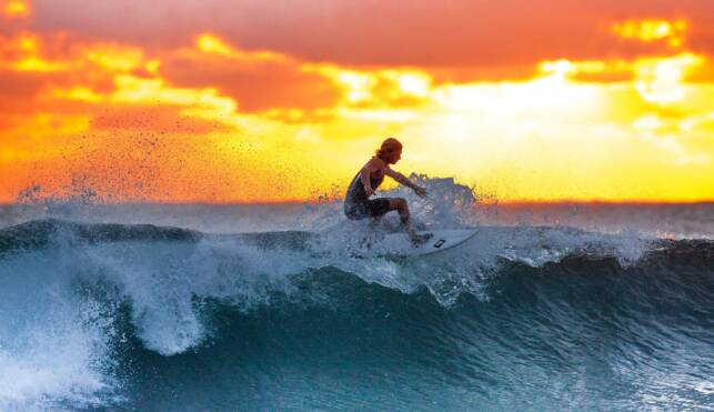 Surfing in Mexico at Sunset